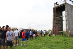 High school students wait in line beneath the rappel tower