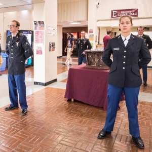 ROTC cadets stand guard around piece of twin towers