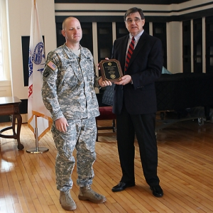 MAJ Snyder is presented the award by history professor Thomas Appleton